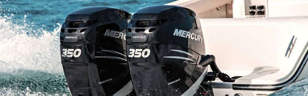 Two Mercury Outboard Engines on the back of a boat.